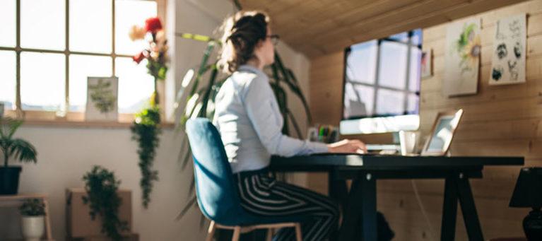 Businesswoman Working In Pet Friendly Office